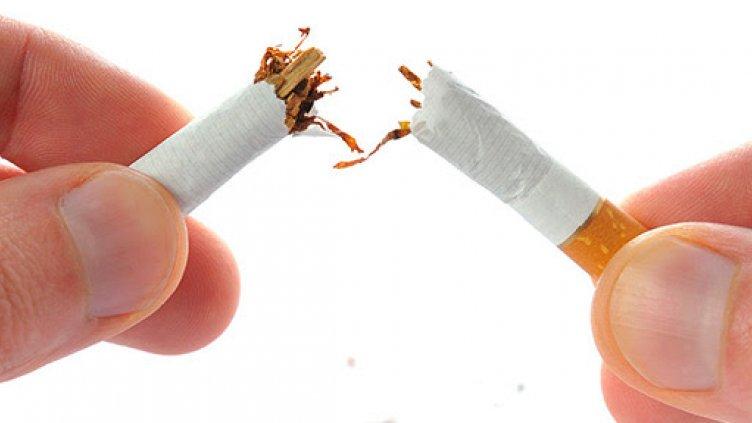 Photo of someone breaking a cigarette in half