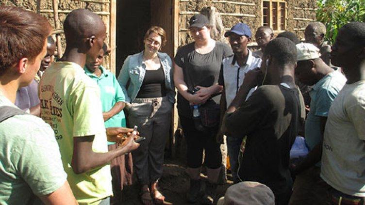 Engineering students meeting with Rwandan villagers