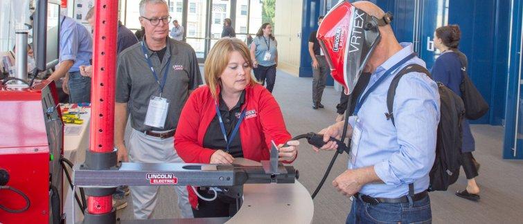 Lincoln Electric representative demonstrates a virtual reality welding simulator
