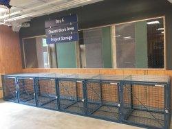 think[box] storage cages beneath signage.